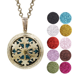Wholesale vintage floats for sale – custom Vintage Bronze Open Snowflake Aroma Perfume Essential Oil Diffuser Locket Floating Charms With Chain for Gift