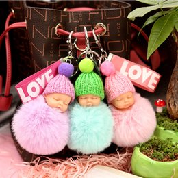 China Sleeping Baby Doll LOVE Ribbon Keychain Cute Doll With Hat Wearing Faux Rabbit Fur Ball Baby Toy Gift for Women Trinket Bag Charms suppliers