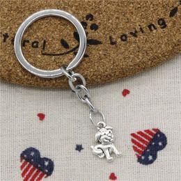 $enCountryForm.capitalKeyWord Australia - Wholesale Fashion Keychain double sided lovely dog 17*12mm Pendants DIY Men Jewelry Car KeyChains Holder Souvenir For Gift
