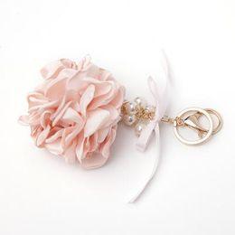 $enCountryForm.capitalKeyWord Australia - Korean Version of the ladies wind Camellia lady bag key ring flower ball pearl luxury car pendant