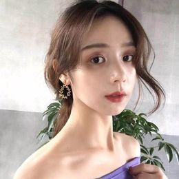Korean Brass Australia - Korean jewelry plated real gold earrings temperament personality metal leaf style joker E078