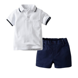 $enCountryForm.capitalKeyWord NZ - Two Pcs Boy Set White Single Breasted Short Sleeved Polo Shirt And Casual Shorts Two-piece Suit Simple Kids Designer Clothes Boys