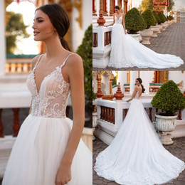 Chinese  2019 White Chapel Train Sleeveless Wedding Dresses Spaghetti Straps Lace Applique Backless Plus Size Beach Bridal Beach Wedding Gowns manufacturers