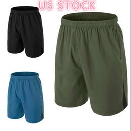 Американский фондовый Мужские шорты для бега мужских повседневных обрезанных коротких штанов Моды спорт Бег колена лета Открытый Мужчины Шорты FY9106 на Распродаже