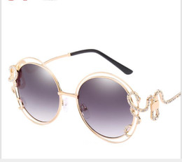 golden eye ring NZ - Ladies'glasses with irregular curved legs drilled in double-ring hollow Sunglasses