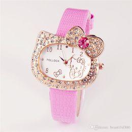 497a469bcb85 Ventas calientes Reloj de Dibujos Animados Hello Kitty Reloj Niños Niña  Estudiante Mujeres Vestido de Cristal Completo Cuarzo dama Reloj de pulsera  Reloj ...