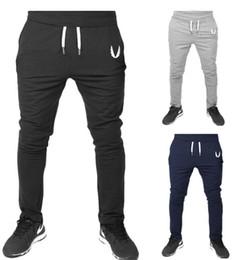 Venta al por mayor de Pantalones de los hombres nuevos mosca muscular V-cuello ala deportes fitness pantalones corriendo calidad de envío buena calidad asiática así que elige un tamaño más grande