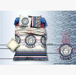 Moda roupas de cama minimalista definir o tamanho do Rei de quatro aloe vera algodão fibra química carta confortável impressão de cama quatro conjuntos AA2145 em Promoção