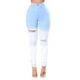 China Autumn Jeans Blue and White Gradient Color Sexy High Waist Feet Jeans Women Tight Bag Hip Trousers supplier sexy hip bag suppliers