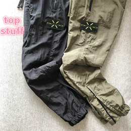 Wholesale black sweat pants for sale – dress 19ss Top nylon mens pants brand travel retro sweat pants details metal nylon mesh breath loose feet ykk zipper shrink trousers for men