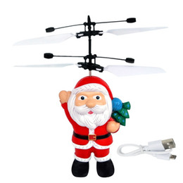 Magic Toys Helicopter UK - Electric Infrared Sensor Flying Santa Claus LED Flashing Light Toys Father Christmas Inductive Aircraft Helicopter Kids Magic Christmas Gift