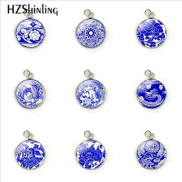 Chinese Porcelain Pendants UK - 12 Patterns Chinese Style Blue And White Porcelain Glass Cabochon Pendant Charms Jewelry Hand Craft Accessories