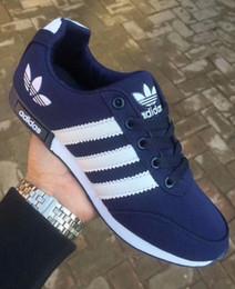 Tamaño 36-44 zapatos corrientes de la marca para los hombres de las mujeres de corte bajo con cordones zapatos deportivos ocasionales zapatillas de deporte unisex al aire libre zapatos para caminar aa6 en venta