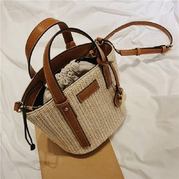 straw drawstring NZ - Straw bag handbags female slung woven bucket bag 2019 new summer holiday beach bag