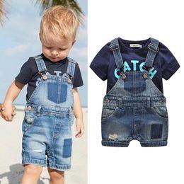 $enCountryForm.capitalKeyWord Australia - Ins Summer newborn outfits baby boy clothes boys clothing sets T shirt+denim jeans Suspenders shorts 2pcs set designer baby suits A6326
