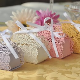 $enCountryForm.capitalKeyWord Australia - 60pcs  Set 76x43x64mm Rose Laser Cut Hollow Carriage Favors Boxes Gifts Candy Boxes With Ribbon Baby Shower Wedding Party Favor Supplies