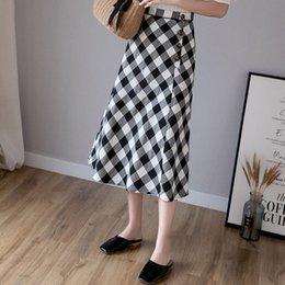 5abf2bc2f0 Estilo coreano Retro Casual Mujeres Faldas Largas Elegante Oficina Señora  Preppy Vintage Aline Plaid Button Verano Negro Falda Mujer