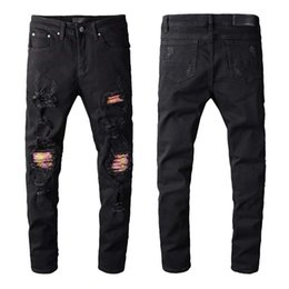 italy jeans brands NZ - 2019 New Arrival Top Quality pant famous Brand Casual Designer Men Denim Jeans Embroidery Wild Pants Fashion Holes Trousers Italy Size 28-40
