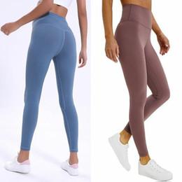 Venta al por mayor de Mujeres de la yoga pantalones de cintura alta Deportes desgaste de la gimnasia LU-32 color transpirable pantalones de estiramiento sólidos y juntos polainas flacas para mujer Pantalones Joggers atléticos
