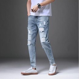 Factory direct jeans online shopping - 2019 summer thin point hole jeans for men s Korean version trend slim men s small feet factory direct sales