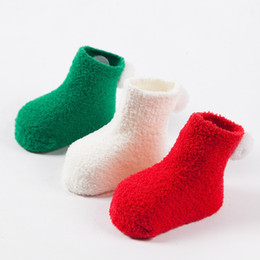Chinese  Lovely Baby Boy Girls Coral Fleece Socks With Cute Ball Solid Color Soft Fluffy Kids Christmas Ball Socks Winter Warm Floor Socks manufacturers