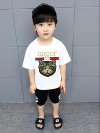 Tees kids boys online shopping - 2019 new brand designer brand years old Baby boys girls T shirts summer shirt Tops cotton children Tees kids Clothing colors t21