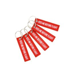 China 5pieces size7.7*2cm Keychain KISS ME BEFORE FLIGHT Warning Pendant duplex Woven label Aviation gift Key chains suppliers