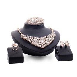 Imitation Pearl Jewelry Sets Australia - Necklace Earrings Bracelet Ring 4-Piece Set Luxury Exaggerated Full Rhinestone and Imitation Pearl 18K Gold Plated Wedding Jewelry Set JS546