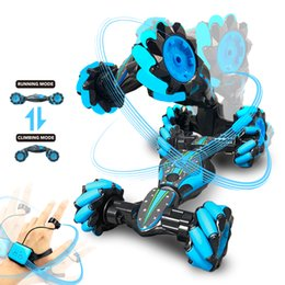 remote control dance Canada - Boys Wirless RC Car Toys Dancing Spinning Car Boys Stunt Dump Remote Control Gesture Sensitive Twist Car Auto Kids Toys Gift Package