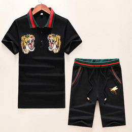 China 2019 new designer summer men clothes Embroidered tiger bee polo red striped neck Tracksuits t-shirt shorts shirt breeches suit sportsuit tee cheap polo shirts pocket men suppliers