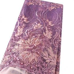 44ad5c44d5 Dubai Africano di alta qualità 2018 Tulle Tessuto di pizzo viola 3D abito  in rilievo Francese tessuti di pizzo nigeriano per la cerimonia nuziale 2019