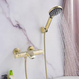 Temperatura Ottone costante vasca da bagno rubinetto fissato al muro del bagno Miscelatore Con acquazzone tenuto in mano i rubinetti Set Spazzolato Oro / Nero in Offerta