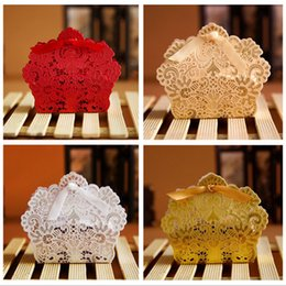 red gold wedding favors UK - 100pcs Laser Cut Hollow Lace Flower White Gold Red Candy Box Wedding Party Sweets Xmas Candy Gift Favors Boxes WX9-1740