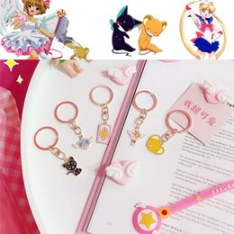 card captor cosplay NZ - Cheap Costume Props Sailor Moon Keychain Cosplay Card Captor Sakura Keyring Metal Girls Halloween Props Kinomoto Sakura Keychains