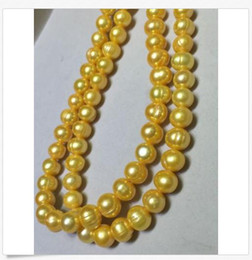 China 35 INCH HUGE NATURAL AAA 11-13MM SOUTH SEA GOLDEN PEARL NECKLACE 14K GOLD CLASP supplier 35 inch south sea pearls suppliers