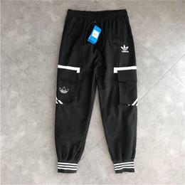 Venta al por mayor de 19SS Marca de lujo Adio trébol pantalones Hombres Mujeres moda hip-hop high street Deportes frescos pantalones de ocio