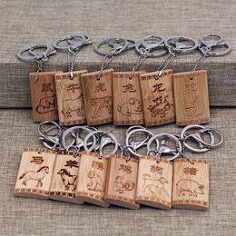 $enCountryForm.capitalKeyWord Australia - Chinese Zodiac bamboo keychain Bamboo carving crafts keychain Car key bag accessories pendant keychain Handmade keyring gift