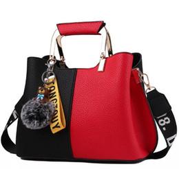 Single Hair Weave UK - AAA+ Color matching two-color handbag 2019 new European and American luxury big crossbody bag ladies shoulder bag hair ball pendant