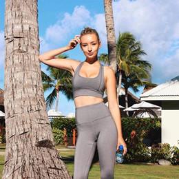 Venta al por mayor de ZC-33 Ropa deportiva de mujer Sólida Conjunto de yoga Ropa de gimnasia para correr Camisa de tenis + Pantalones Leggings de yoga Entrenamiento deportivo Traje