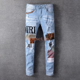 Wholesale european designer jeans resale online – designer Light Blue Patch Embroidered Fashion Jeans Trendy Fashion European and American High Street Brand Jeans Casual Stretch Slim Feet Jeans