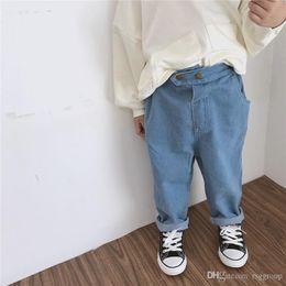 $enCountryForm.capitalKeyWord NZ - Autumn Newest Fashion Designs INS Kids Boys Girls Jeans Trousers Fashion Back Front Double Buttons Pockets Autumn Children Girls Denim Pants