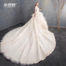 60bb051367 Manufacturer Direct Sales Wedding Dresses 2018 New Long Tail Shoulder  Princess Dream Hepburn Bride Slim European-style