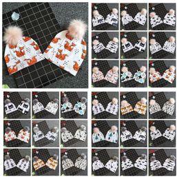 0cfeb6d7400 31 Styles Baby Animals Printed INS Beanies Panda Hats Shark Bear Girls Boys  Faux Fur Pompom Ball Earmuffs Caps CCA10887 60pcs