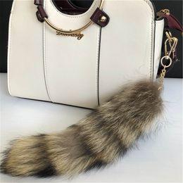 $enCountryForm.capitalKeyWord NZ - 100% Real American Raccoon Fur Tail Keychians Plush Pom Poms Women Gifts Keyrings Car KeyChain Bag Charm