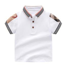 Boys White Plaid Shirt NZ - New Summer White Short Sleeve Baby Boys Girls T-shirts Fashion Plaid Lapel Shirt Tops Cotton Children Tees Kids Clothing