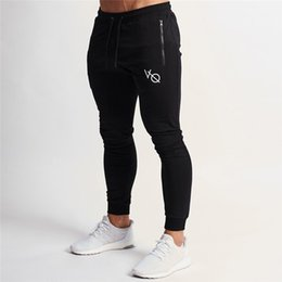 Discount white jogger pants mens - 2019 Spring New Mens Gyms Fitness Skinny Sweatpants Trousers Joggers Workout Sportswear Male Casual Fashion Brand Pants