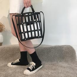 Ladies Bucket Handbags Australia - NIGEDU Hollow Bucket bag for women handbag Famous Brands PU leather female shoulder bag 2019 new Beach for Ladies Totes