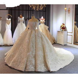 Discount dubai wedding gowns Luxury Champagne Beaded Ball Gown Wedding Dresses Vintage Arabic Dubai Crystal Plus Size Off Shoulder Long Sleeves Brida
