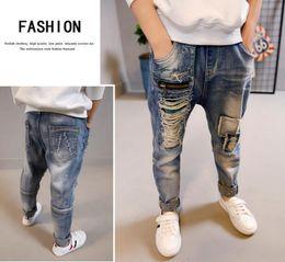 Kids wearing jeans online shopping - Children wear boys trousers spring boy jeans big boy hole children pants tide Kids Clothing