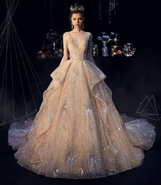 dropped wedding dresses NZ - 2019 Sexy Bling Sequined A Line Wedding Dresses Deep V Neck Wedding Gowns Floor Length Ball Gown Backless Custom Plus Size Bridal Dress